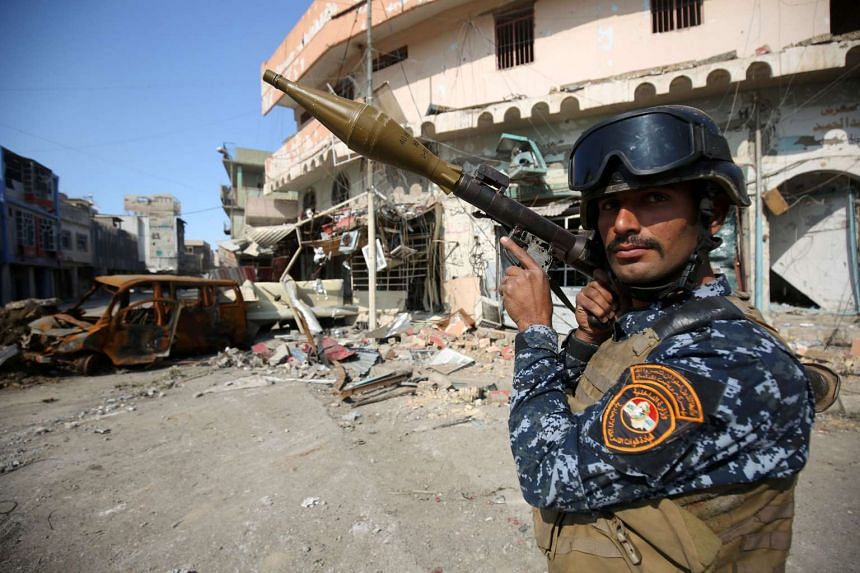 A member of the Iraqi forces stands guard at the frontline of the Old City of Mosul on March 25, 2017.
