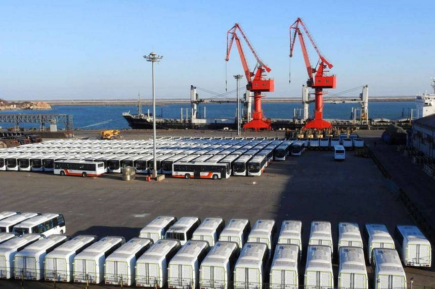 Buses sit lined up at the docks waiting to be exported at a port in Lianyungang, in eastern China's Jiangsu province on Jan 20, 2017.