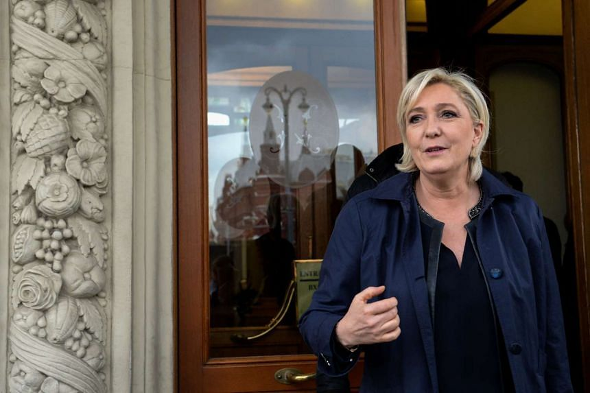 French presidential election candidate for the far-right Front National (FN) party Marine Le Pen leaves Moscow's Hotel National on March 24, 2017.