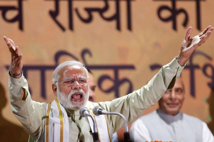 India's Prime Minister Narendra Modi addresses his supporters at Bharatiya Janata Party (BJP) headquarters in New Delhi on March 12, 2017.