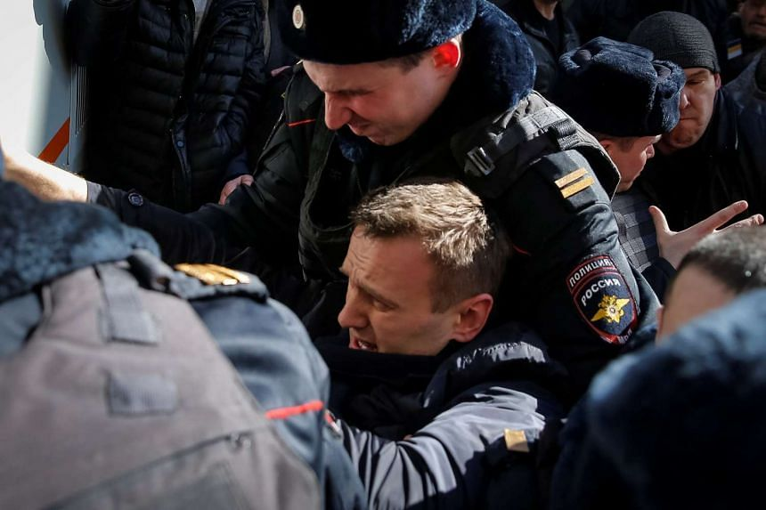 Police officers detain anti-corruption campaigner and opposition figure Alexei Navalny during a rally in Moscow, Russia,on March 26, 2017.