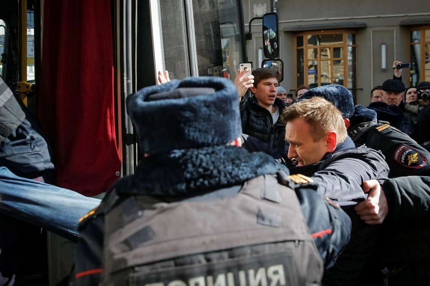 Police officers detain anti-corruption campaigner and opposition figure Alexei Navalny during a rally in Moscow, Russia, on March 26, 2017.