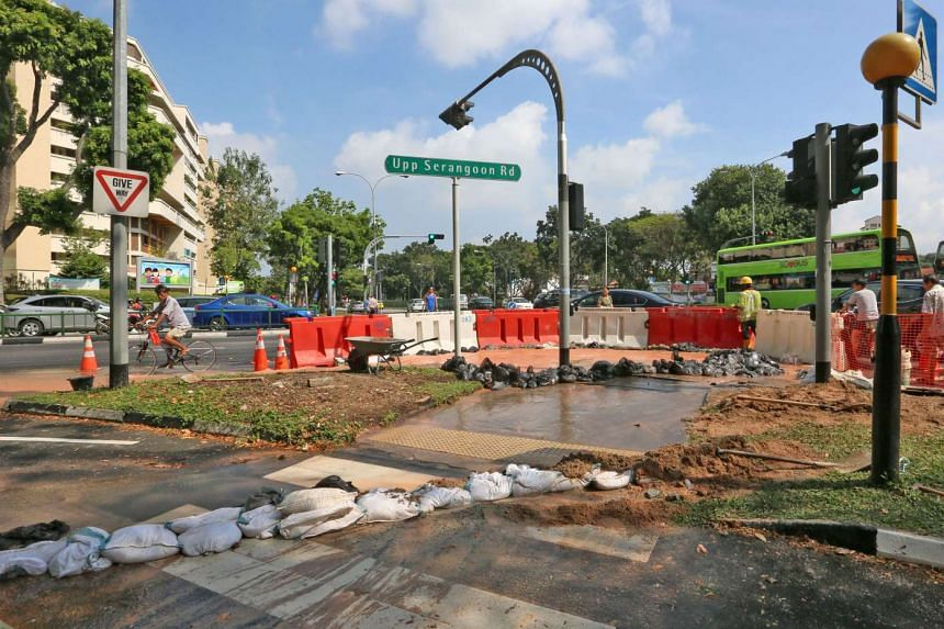A water pipe leak near the junction of Upper Serangoon Road and Hougang Avenue 3 covered part of the roads with water.