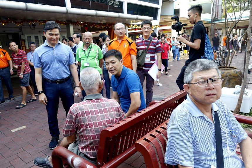 Minister Tan Chuan-Jin (in blue) talking to a resident during his visit to the Toa Payoh East-Novena ward in Bishan-Toa Payoh GRC.