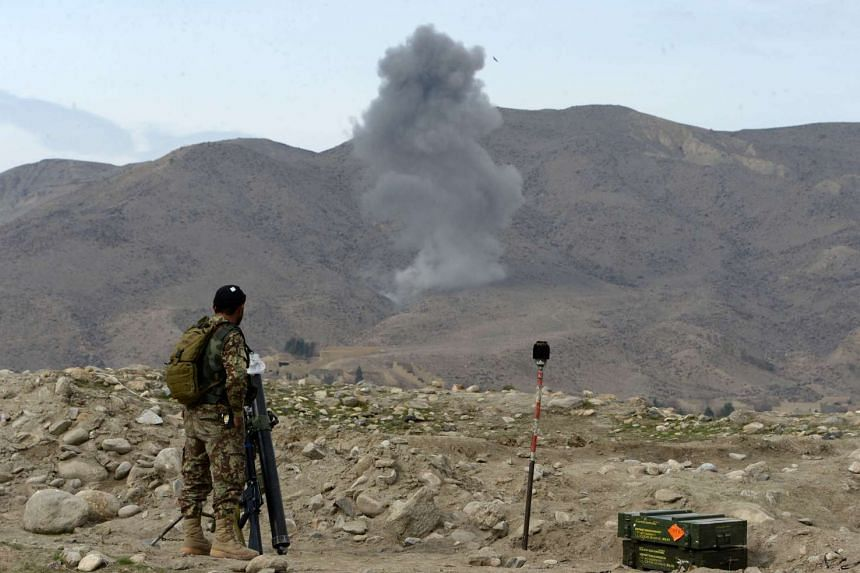 Smoke rises after an air strike by US aircraft on positions during an ongoing an operation against Islamic State militants in Kot district of Nangarhar province on Feb 16, 2017.