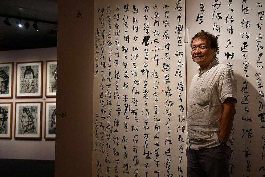 Artist Tan Swie Hian at the National Library's exhibition of his artworks, Anatomy Of A Free Mind – his biggest show to date. More than 100 of his works will be on display until April 24. Behind him is The Preface To Tour Of Three Gorges Stone Engravings