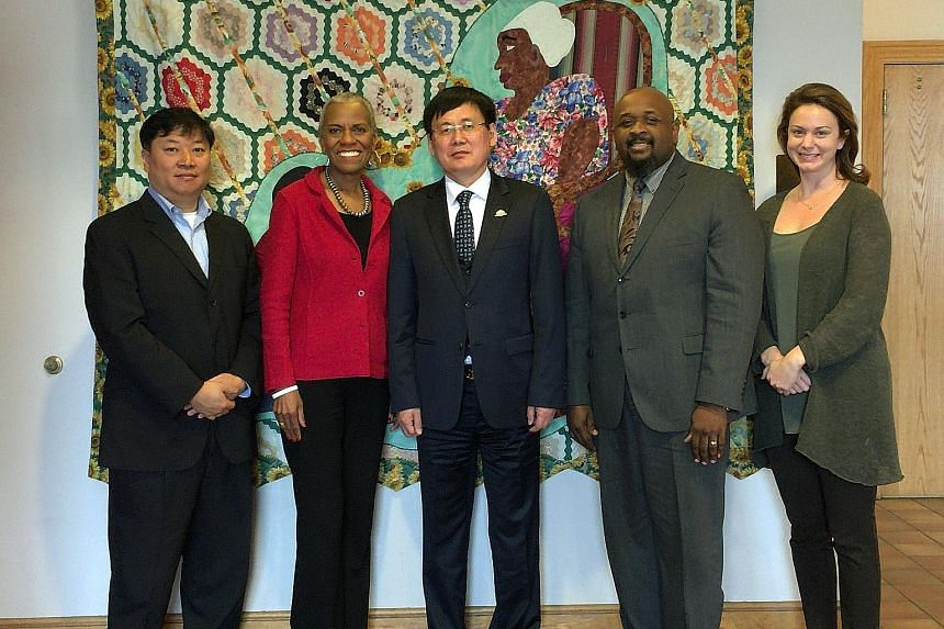 """North Korean defector Jung Gwang Il (centre) during a visit to the Birmingham Civil Rights Institute in Alabama, where he spoke out earlier this month against the Kim Jong Un regime. The assassination in Malaysia has """"emboldened and encouraged"""" him t"""
