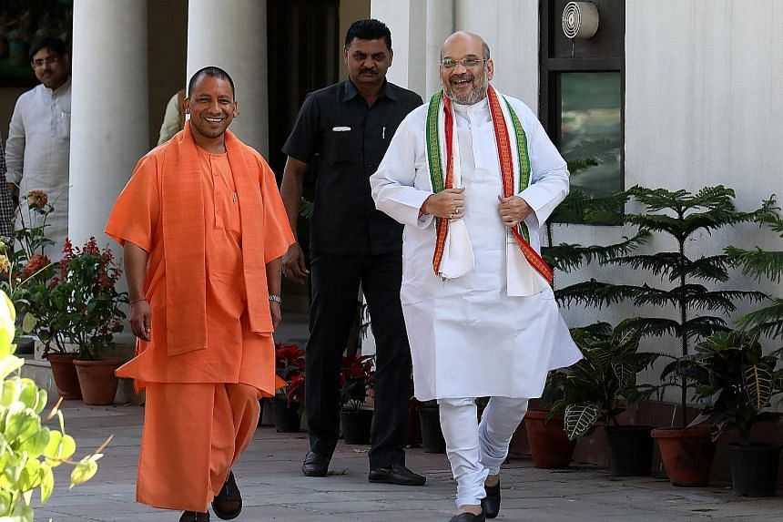 Mr Adityanath (far left), the new chief minister of Uttar Pradesh, with Bharatiya Janata Party president Amit Shah (in white) in New Delhi last week. Mr Adityanath's recent policy has been criticised as moral policing.