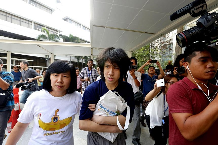 Amos Yee (centre) walking away from the State Courts on July 6, 2015 with his mother, Madam Mary Toh (right).