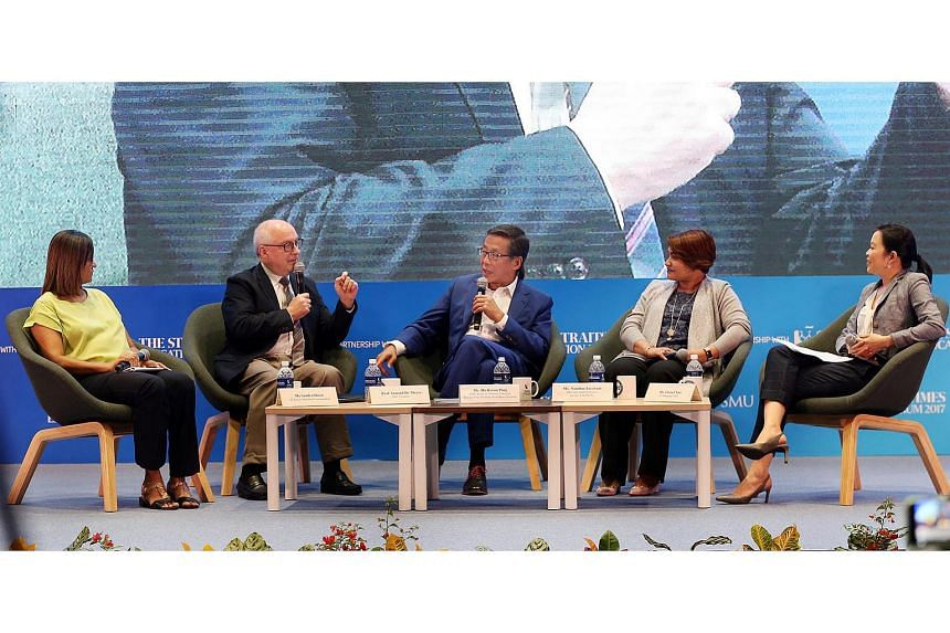 Panellists at the ST Education Forum 2017 were (from left) ST senior education correspondent Sandra Davie, SMU president Arnoud De Meyer, SMU's board of trustees chairman Ho Kwon Ping, Ms Nandini Jayaram, the South-east Asia human resource lead for G