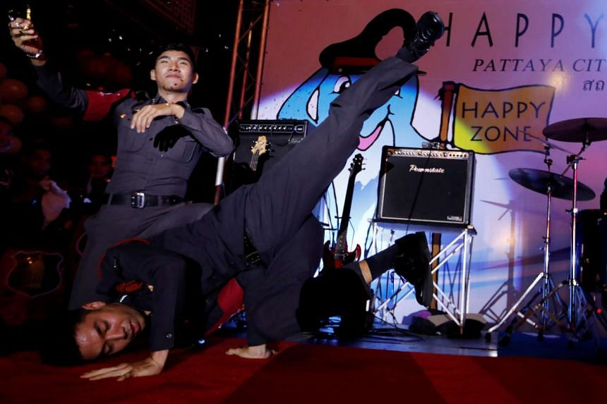 """Policemen dance during the launch of the """"Happy Zone"""" program aimed at improving the image of the city in Pattaya, Thailand"""