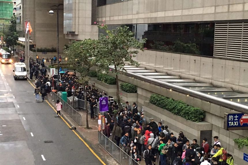 Media queueing to register to cover Hong Kong's chief executive election.
