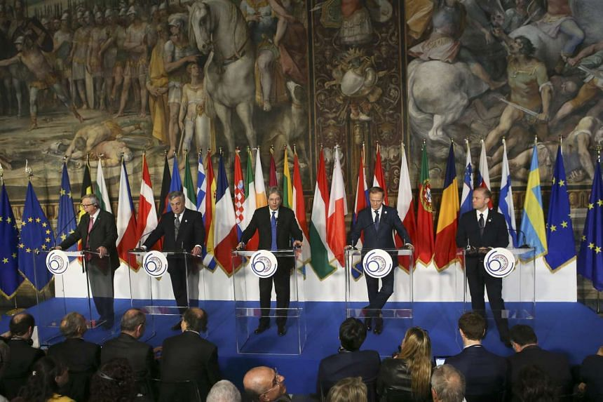 EC President Jean-Claude Juncker and other EU leaders attend a news conference n the 60th anniversary of the Treaty of Rome, in Rome on March 25, 2017.
