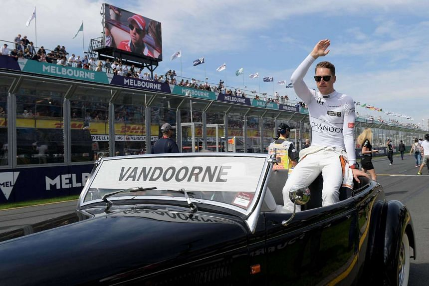 Belgian driver Stoffel Vandoorne of McLaren Honda waves to fans during the Drivers Parade ahead of the 2017 Formula One Australian Grand Prix on March 26, 2017.