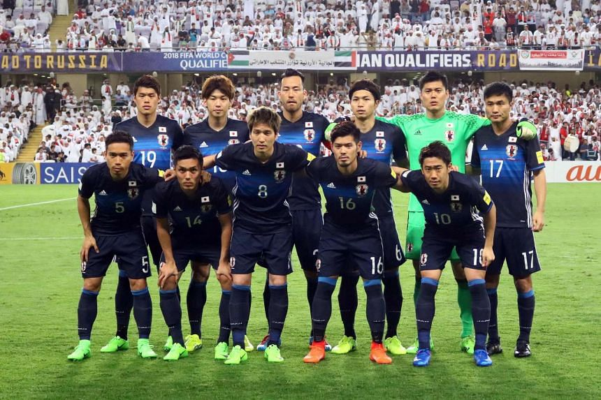 Japan's starting eleven pose for a group picture ahead of the FIFA World Cup 2018 qualifier between UAE and Japan on March 23, 2017.