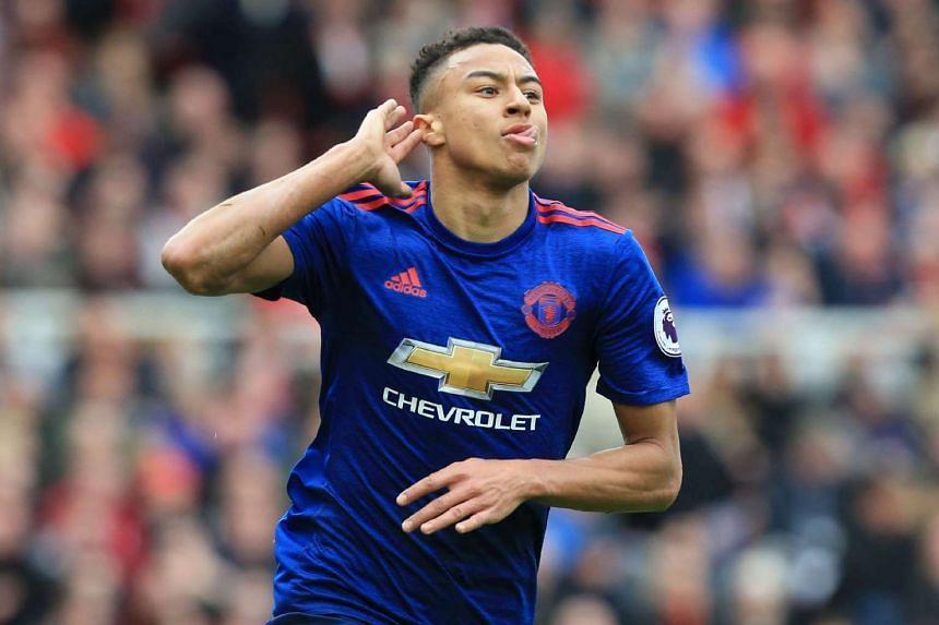 Manchester United's English midfielder Jesse Lingard celebrates after scoring their second goal during the English Premier League football match between Middlesbrough and Manchester United on March 19, 2017.
