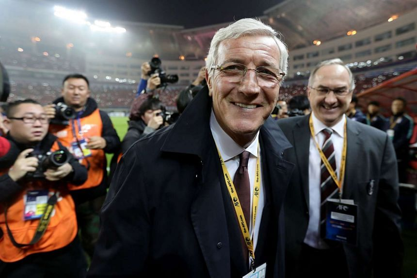 China's head coach Marcello Lippi leaves after the World Cup football qualifying match against South Korea in Changsha, China, on March 23, 2017.