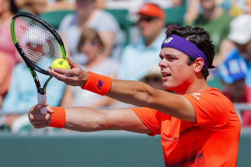 Milos Raonic of Canada in action against Viktor Troicki of Serbia at the Miami Open, March 24, 2017.