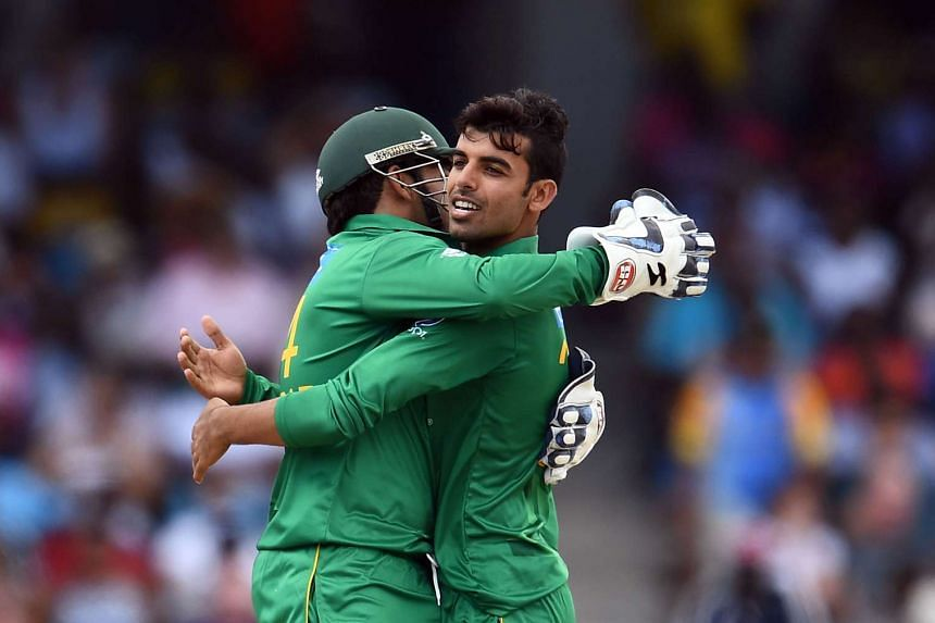 Pakistan's Shadab Khan (right) celebrates with team captain/wicketkeeper Sarfraz after dismissing West Indies' Sunil Narine.
