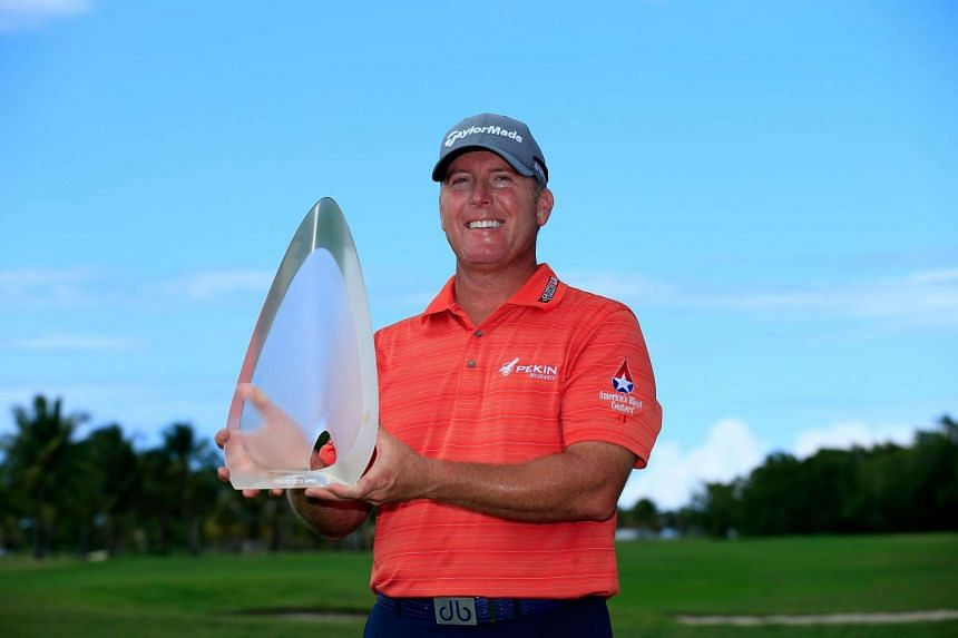 D.A. Points holds his trophy after winning the Puerto Rico Open at Coco Beach on March 26, 2017.