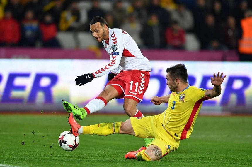 Alin Tosca (right) of Romania vies with Martin Braithwaite of Denmark during the Fifa World Cup 2018 qualification match in Cluj-Napoca, Romania.