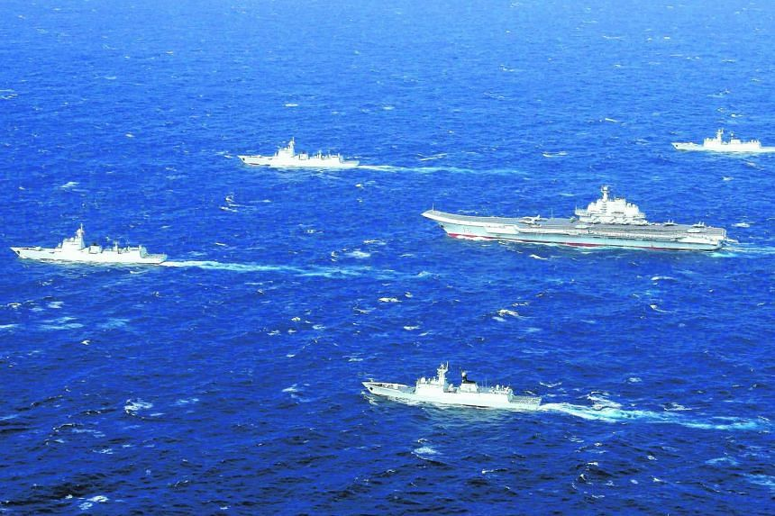 This aerial photo taken on Jan 2, 2017 shows a Chinese navy formation, including the aircraft carrier Liaoning (centre), during military drills in the South China Sea.