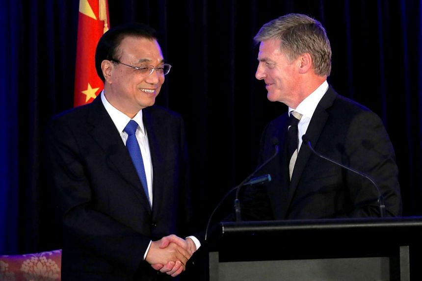 Chinese Premier Li Keqiang shakes hands with New Zealand's Prime Minister Bill English during a media conference in Wellington.
