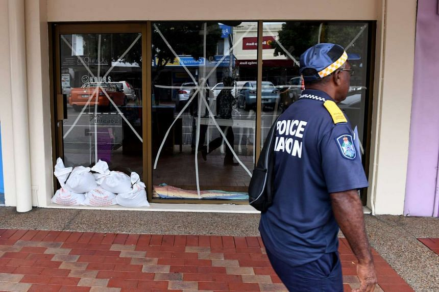 A shop's window is taped up and sandbagged in Ayr near Townsville, Queensland, Australia, on March 27, 2017.