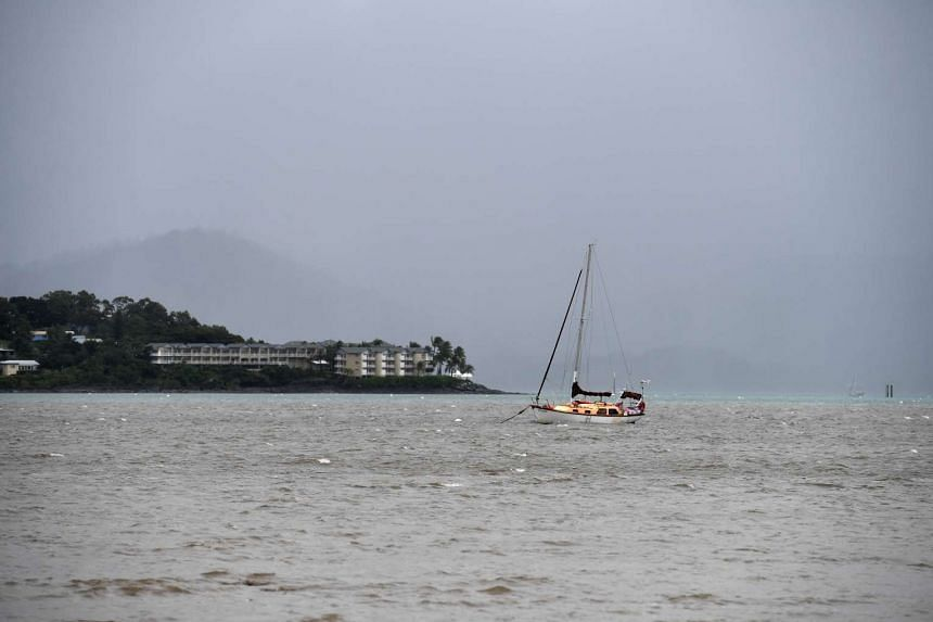 A boat is moored off Airlie Beach as dark clouds approach in Queensland, Australia, on March 27, 2017.