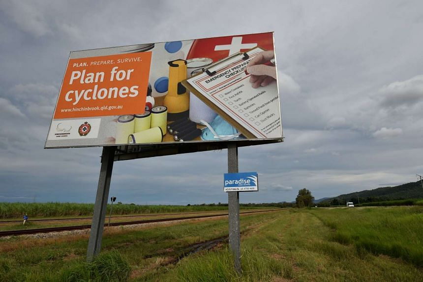 A cyclone warning sign is seen outside the city of Townsville in far north Queensland on March 27, 2017.