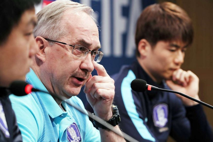 South Korea's national football team head coach Uli Stielike (centre) speaks during a press conference at the National Football Center in Paju, South Korea, on March 27, 2017.