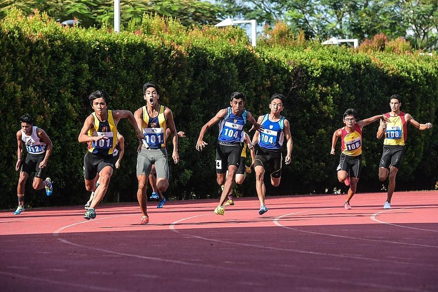 CJC's anchor runner Hassan Khan (centre) about to receive the baton from Alphonsus Teow in the 4x100m boys' A Division final of the SPH Schools Relay Championships at Bishan Stadium. ACS(I) (left) were leading marginally at the time but Hassan caught