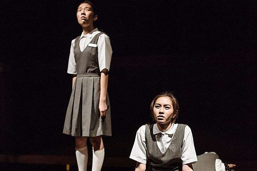 Claire Chung (left) as the school's enfant terrible and Audrey Teong (far left) is her gawky best friend in Normal.
