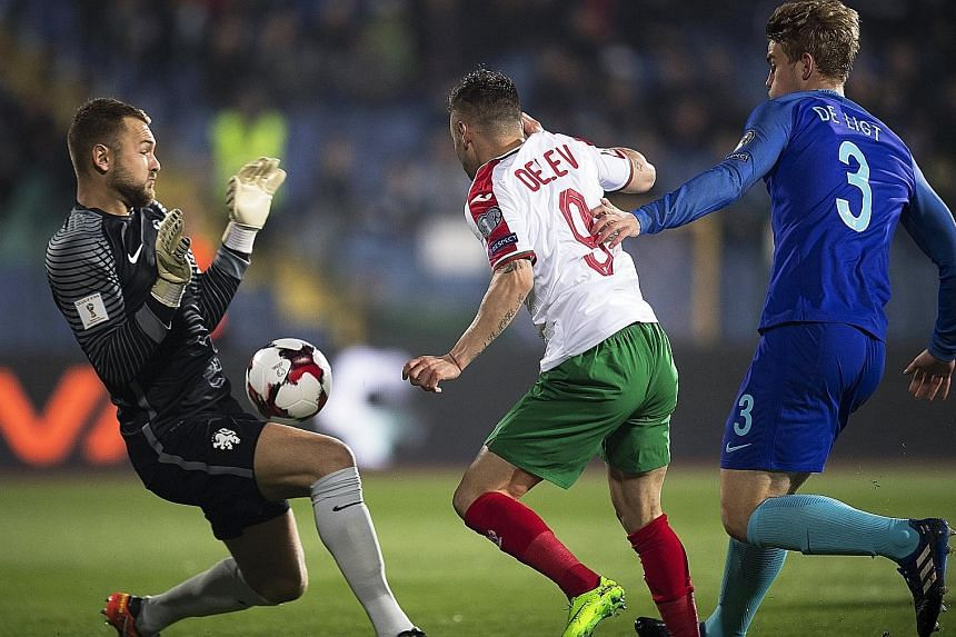 Spas Delev of Bulgaria scoring the first of his two goals in the 2-0 victory in the World Cup qualifier against the Netherlands in Sofia on Saturday. They were his first international goals and kept his country on course to reach the World Cup Finals