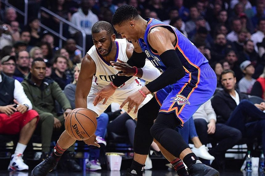 Chris Paul (left) dispossesses Russell Westbrook. The Clippers' star has 1,898 steals - more than any active NBA player.