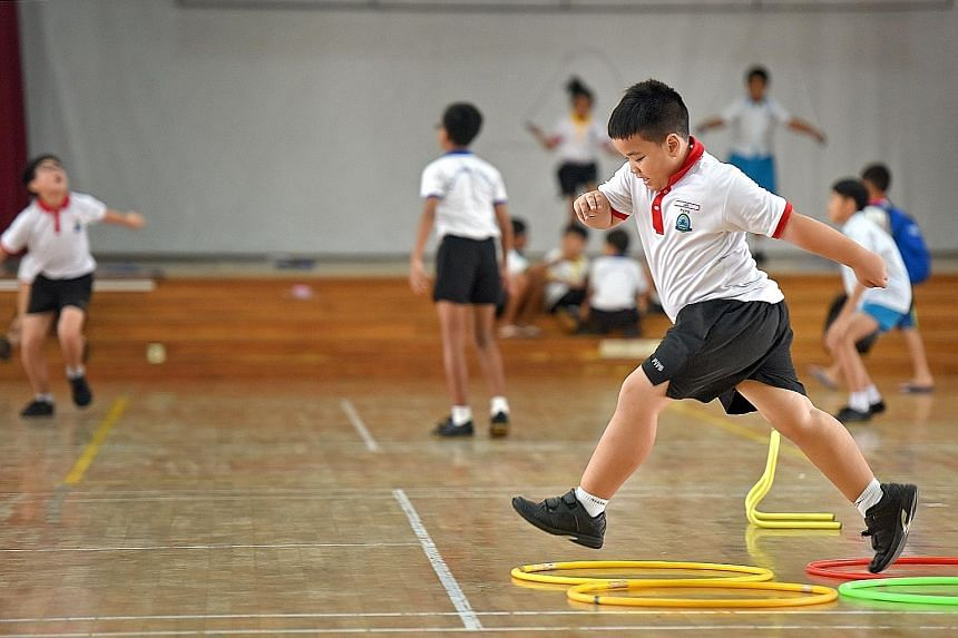 Park View Primary School pupils participating in various physical activities during recess, as part of the school's Fun And Fitness programme. Though the programme is targeted at overweight pupils, the Active Play @ Recess component is open to all an