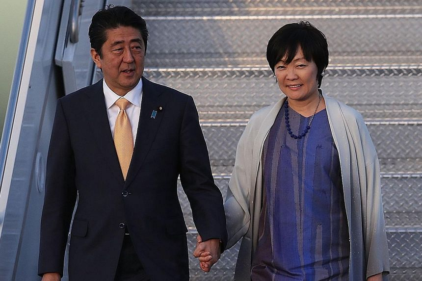 Japanese Prime Minister Shinzo Abe and his wife Akie Abe arriving at the Palm Beach International Airport to meet US President Donald Trump and his wife last month. Known for holding hands with her husband in public among other characteristics, Mrs A