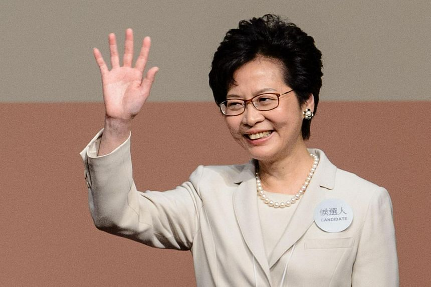 Hong Kong's new chief executive Carrie Lam waves after winning the Hong Kong chief executive election.