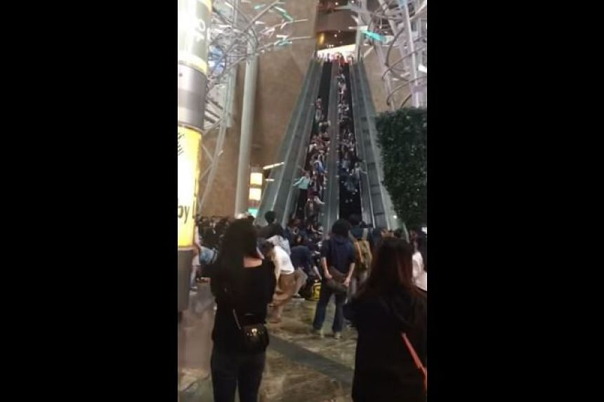 At least 18 people were injured in a Hong Kong shopping mall after an escalator suddenly went into reverse at high speed.
