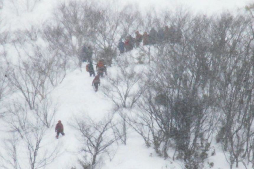 Rescue workers conducting search operations after an avalanche, in Nasu, Tochigi prefecture, on March 27, 2017.