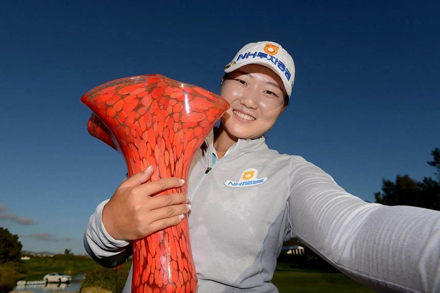Lee Mi Rim poses with the winner's trophy after her -20 under par (268) tournament record during the final round of the KIA Classic at the Park Hyatt Aviara Resort on March 26, 2017 in Carlsbad, California.