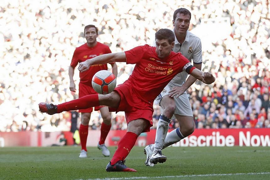 Liverpool's Steven Gerrard scores their fourth goal in a charity match at Anfield.