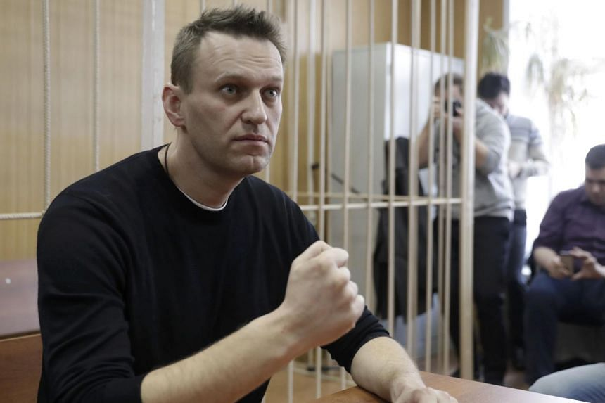 Russian opposition leader Alexei Navalny attends a hearing after being detained at the Tverskoi court in Moscow on March 27, 2017.
