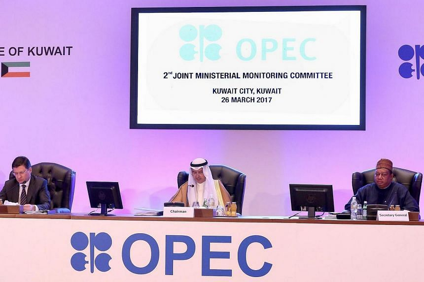 (From left) Russian Energy Minister Alexander Novak, Kuwait's Oil Minister Essam al-Marzouq and Opec secretary general Mohammad Sanusi Barkindo attend a meeting for the 2nd Joint Ministerial Monitoring Committee of Opec.