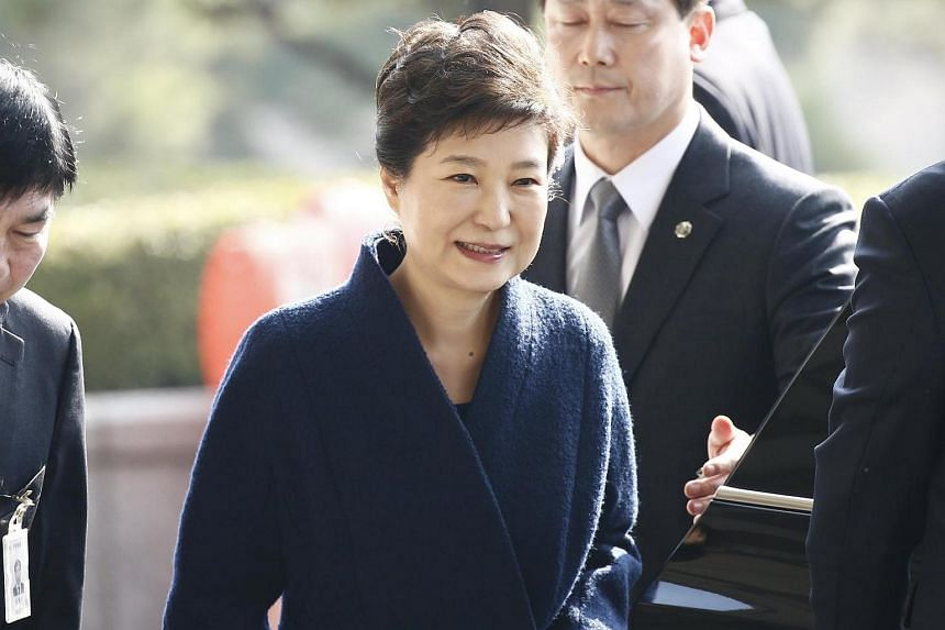 Impeached South Korean former president Park Geun Hye arriving at the Seoul Central District Prosecution Office for questioning on March 21, 2017.