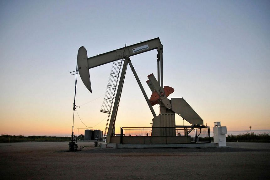 A pump jack operates at a well site leased by Devon Energy Production Company near Guthrie, Oklahoma, on Sept 15, 2015.