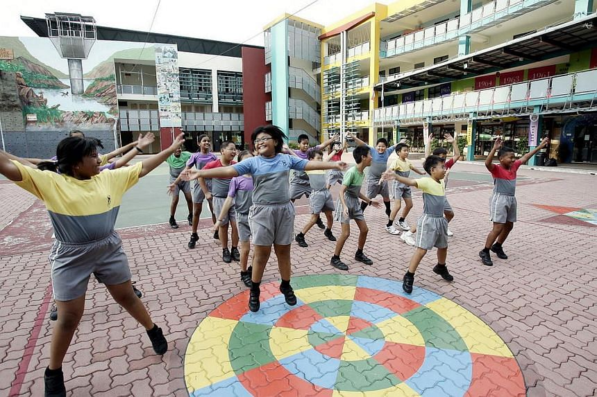 Students at Hougang Primary School exercising after classes.