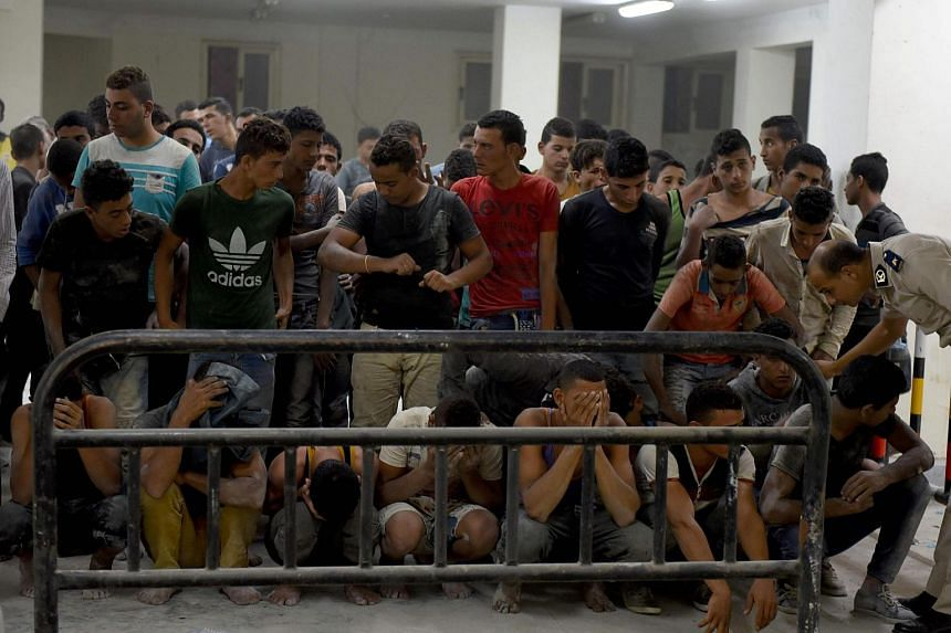 Survivors from a boat that capsized off Egypt's north coast are seen in a police station in Rashid in northern Egypt on Sept 22, 2016.