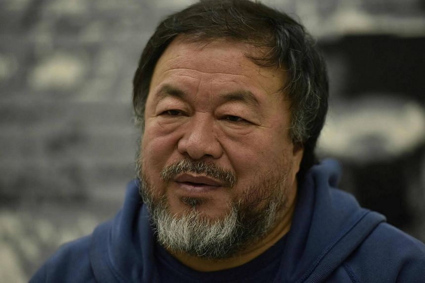 Ai Weiwei speaking to AFP reporters in his studio in Berlin, on Feb 21, 2017.
