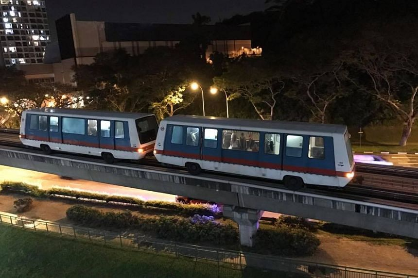 Commuters disembarking from the Bukit Panjang LRT after a train fault caused the train car to stop between stations.